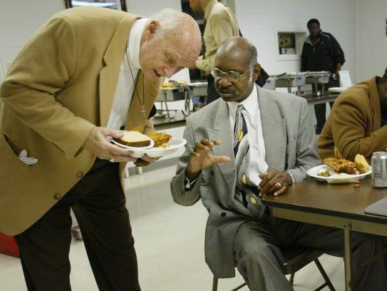 FILE — Bill Barnes talks with Bishop George Price during