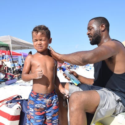 Thousands of spectators crowd Pensacola Beach on Saturday,