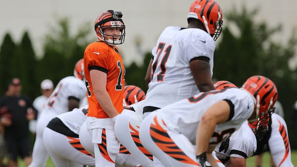 Quarterback Andy Dalton wears a Go-Pro camera on his helmet during Cincinnati Bengals training camp on the practice field at Paul Brown Stadium on Monday.