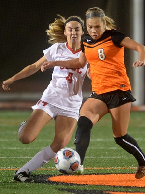 Josselayne Pereda (8), right, of Ventura College and Katherine Sheehy of Santa Barbara City College battle for control of the ball Tuesday night in Ventura.