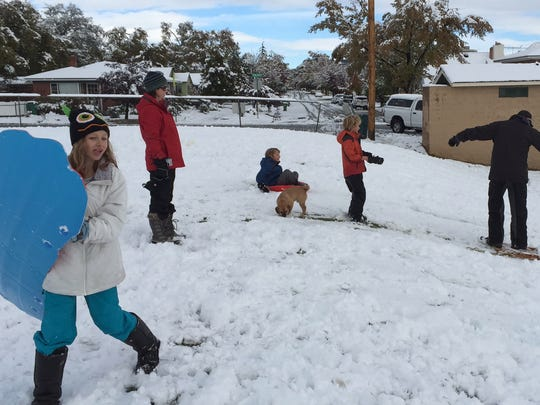 Kids play in Reno's Plumas Park after snow caused schools to be canceled.