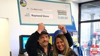 Randy Shove, of Ontario, Wayne County, with New York State Lottery spokeswoman Yolanda Vega.