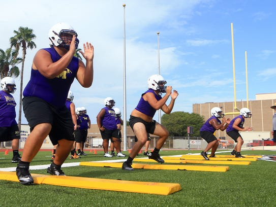 Miller players run through drills during practice on