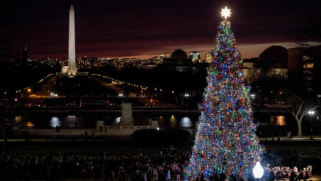 The 2017 Capitol Christmas Tree is lit on the West Lawn of the U.S. Capitol, Wednesday, Dec. 6, 2017, in Washington. The Capitol Christmas Tree has been a tradition since 1964, and this year's tree was chosen from Kootenai National Forest in Montana.