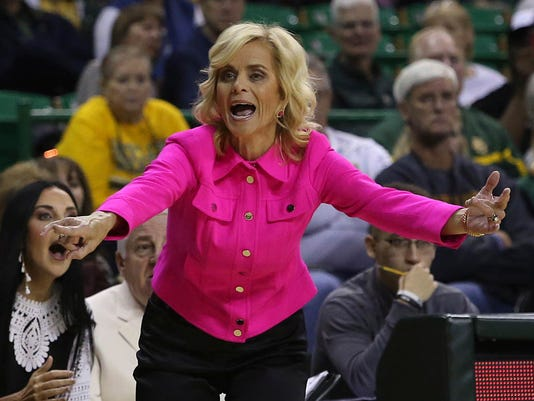 Baylor coach Kim Mulkey directs her team during the first half of an NCAA college basketball game aganst Lamar, Friday. Nov. 10, 2017, in Waco, Texas. (AP Photo/Jerry Larson)