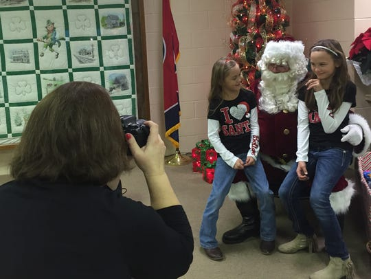 Photos with Santa Claus is a tradition at Erin's annual