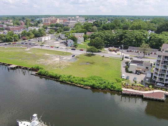 A rare piece of open property along the Wicomico River in downtown Salisbury has been purchased by a company that plans to open a shopping and dining complex.