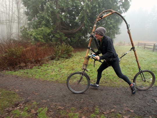 Ted Schmid takes off in his Bamboocycle. He engineered