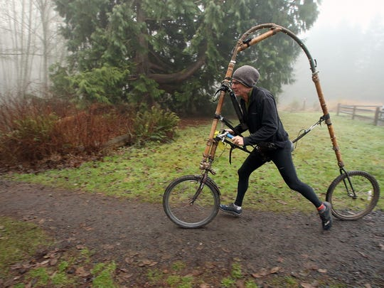 Ted Schmid takes off in his Bamboocycle. He engineered the device and built it using old bicycle parts.