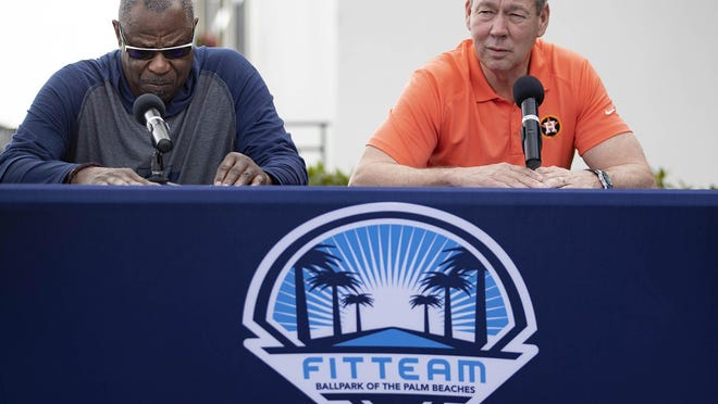 Houston Astros new manager Dusty Baker, left, listens as team owner Jim Crane answer questions about sign stealing scandal during a press conference before the start of spring training at Fitteam Ballpark of the Palm Beaches in West Palm Beach, Feb. 13, 2020.
