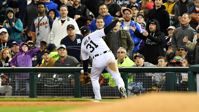Tigers first baseman Alex Avila makes a catch in foul territory in the seventh inning. The ball for just a second almost comes out of his glove but he holds on.