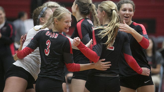 The SPASH volleyball team celebrates a point at Stevens Point Area Senior High School, Tuesday.