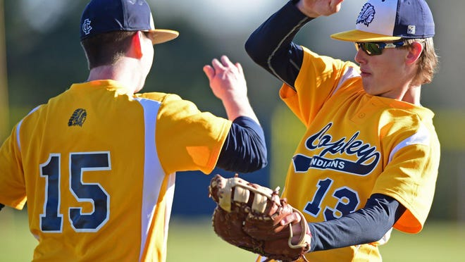 Copley's Tyler Hayes, right, celebrates with teammate Jarod Deagan after the final out of an inning in a game against Tallmadge.