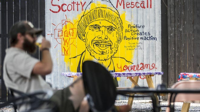 Austin musician and visual artist Tim Kerr painted a mural honoring Scott Mescall at Far Out Lounge, where the former Austin Land & Cattle employee ran a food truck and was considered the bar's unofficial mascot.