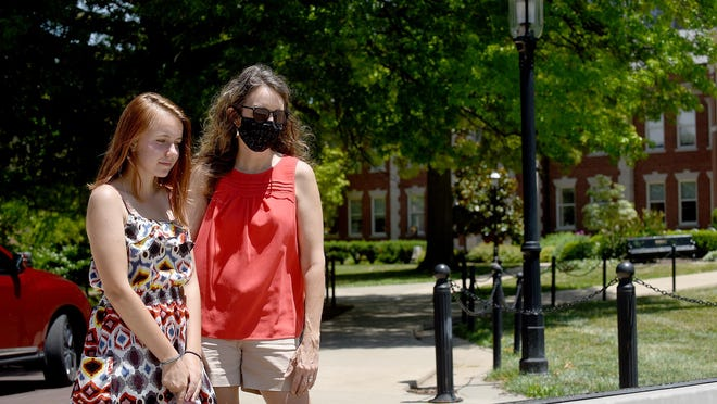 Bryna Kelley, left, and her mother Kristen Kelley from Albuquerque, New Mexico visit the University of Missouri on Monday as Bryna considers her college choic. Under a proposed city ordinance, everyone over age 10 would have to wear a mask anytime they may encounter people without the ability to social distance, whether indoors or out and in both public and private settings.
