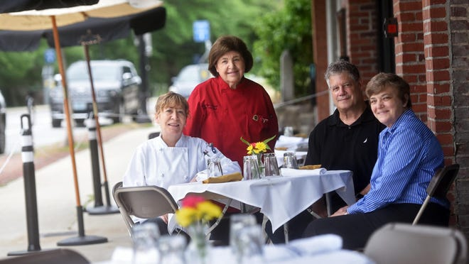 Ciao Italia Ristorante + Mercato has opened on Main Street in Durham. The creative team behind the restaurant sits in the restaurant's outdoor seating area. From left are Executive Chef Jeanne Clements, longtime TV cooking show chef Mary Ann Esposito,  owner Doug Clark and managing partner Deb Weeks.