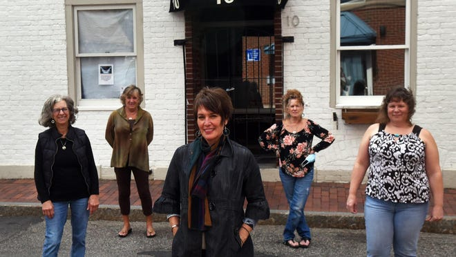 Barber Sandy Cole, center, is taking over the Clip Joint Barbers with her staff behind her at their new space at 10 Ladd St. in Portsmouth. The last day on Daniel Street will be Sept. 26 and it will reopen at the beginning of October. From left, barbers Patti Lacivita, Debbie Ann Oliver, Sandy Cole, Colleen Baker and Cherie Bouchard.