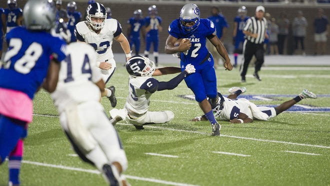 MarQuise Burnett of Burke County rushes for a nice gain against Statesboro defenders at the high school football game between Burke County and Statesboro in Wayneboro, GA, Friday, October, 4 2019. [MIKE ADAMS/SPECIAL] \r