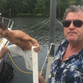 """Greg, right, and James Lisky prepare their boat """"Hard Times"""" for the approach of Tropical Storm Hermine."""