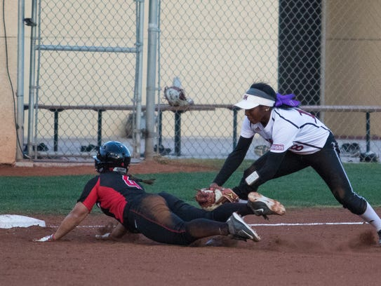 NMSU's Rachel Rodriguez gets the tag out at third base