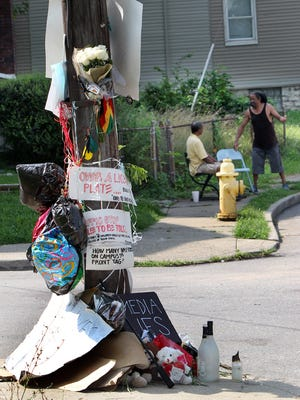A memorial to Samuel DuBose, shot and killed during a traffic stop by a University of Cincinnati police officer, stands at the corner of Valencia and Rice streets in Mount Auburn, near where the incident occurred.