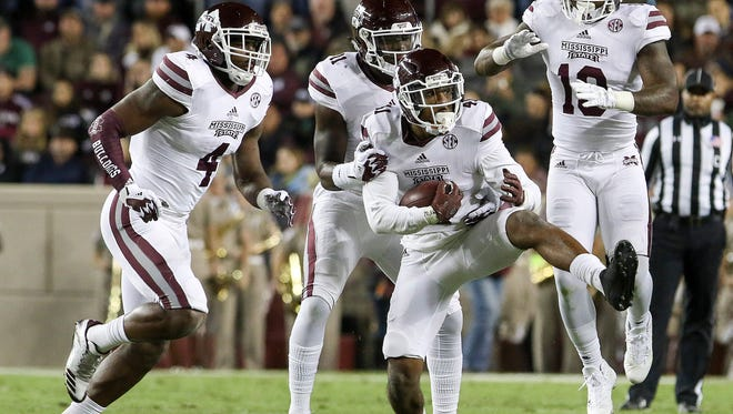 Mississippi State Bulldogs defensive back Mark McLaurin (41) celebrates after catching a interception in the second quarter against the Texas A&M Aggies at Kyle Field. Mandatory Credit: John Glaser-USA TODAY Sports