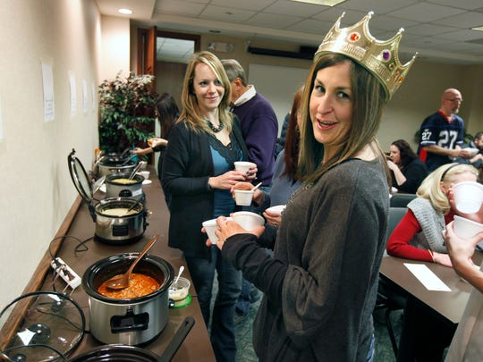 Human resources coordinator Melissa Briggs and operations associate Jen Fox participate in an employee soup contest lunch at Sage, Rutty & Co. in Rochester in January.