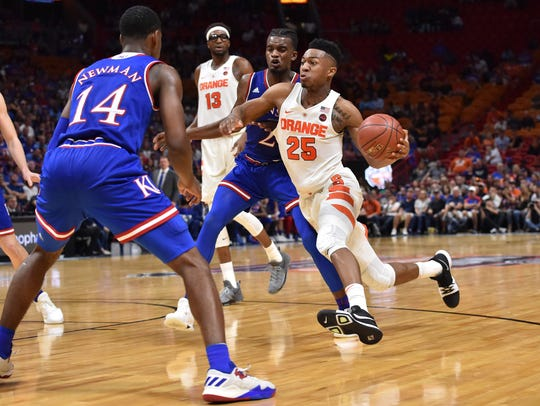 Syracuse guard Tyus Battle (25) drives on Kansas Jayhawks