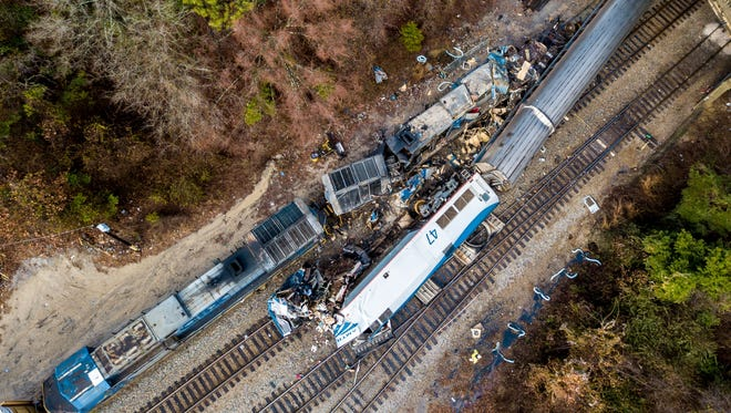 An aerial view of the site of a fatal train crash Feb. 4, 2018, between an Amtrak train, bottom right, and a CSX freight train, top left, in Cayce, S.C.
