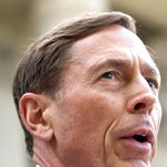 Former director of CIA and former commander of U.S. Forces in Afghanistan Gen. David Petraeus gives a speech after exiting the federal courthouse after facing criminal sentencing on April 23, 2015 in Charlotte, North Carolina. Petraeus faced criminal sentencing for giving classified information to his former mistress and biographer.