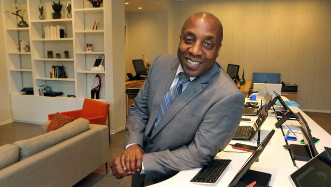 Bruce Jackson, the assistant general counsel for Microsoft Corp., in the Interactive Center at the company's offices in New York City. He went from founding the highly successful entertainment law firm of Jackson, Brown, Powell and St. George in 1993, representing some of Mount Vernon's top performing artists, to advancing a $4 billion regional sales business unit in negotiating licensing and contracts at Microsoft.