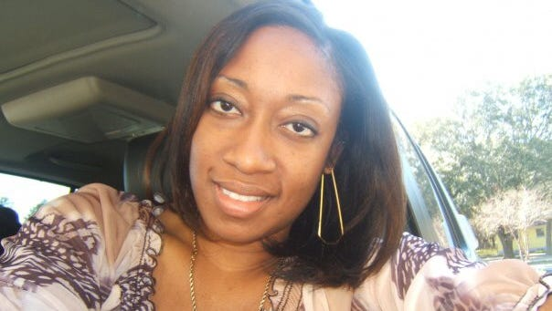 Undated family photo shows Marissa Alexander in Tampa, Fla. Alexander had never been arrested before she fired a bullet at a wall one day in 2010 to scare off her husband when she felt he was threatening her.