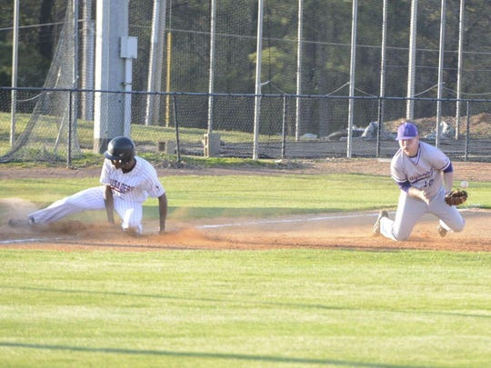 Haywood's Colton Lilly (12) fields a grounder against