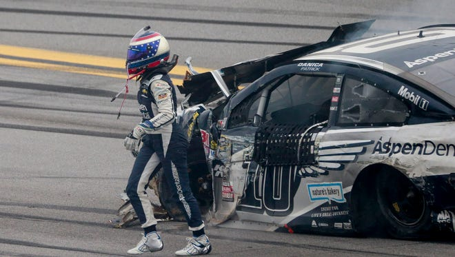 Danica Patrick walks briskly away from her car after it catches fire following a crash during Sundays' GEICO 500 at Talladega Superspeedway.