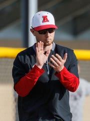 Arrowhead varsity coach Nick Brengosz applauds his