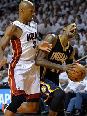 Pacers forward Paul George collides with Heat guard Ray Allen during Game 4.