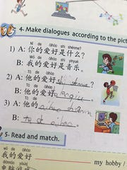 Matteo Dalessandro's workbook inside his Mandarin class at Our Lady of Lourdes school in De Pere.