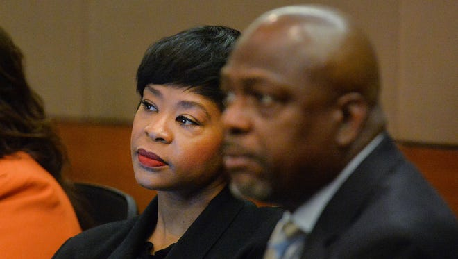 Former Deerwood Academy Assistant Principal Tabeeka Jordan, left, and her defense attorney Akil Secret listen as Fulton County Superior Court Judge Jerry Baxter gives the jury the charge in the Atlanta Public Schools test-cheating trial in Fulton County Superior Court on Thursday, March 19, 2015, in Atlanta. On Wednesday, April 1, 2015,  Jordan and 10 other former educators were found guilty of racketeering. Only one of the former educators was acquitted of racketeering charges.