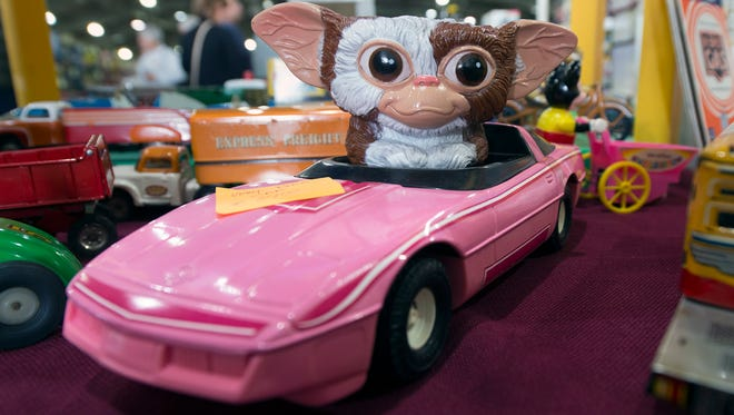 Gizmo riding a pink Pontiac Firebird from the 1980s during the 35th annual Greater York Toy Extravaganza at the York Expo on Sunday.