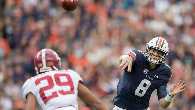 Auburn quarterback Jarrett Stidham (8) throws against Alabama in first half action in the Iron Bowl in Auburn, Ala. on Saturday November 25, 2017.