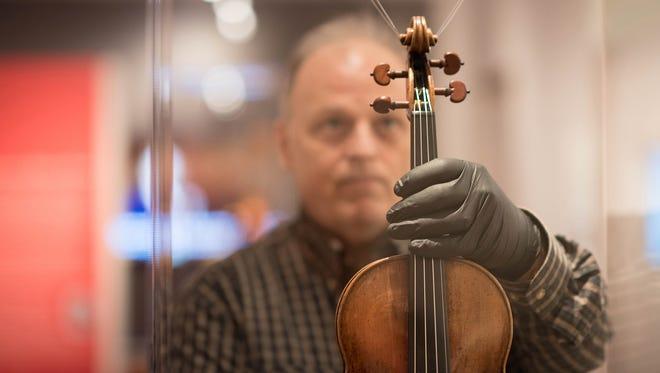 "Luthier Gregg Alf installs the ""Prince Doria"" violin, ca. 1734, by Bartolomeo Giuseppe Guarneri ""del Gesù."""