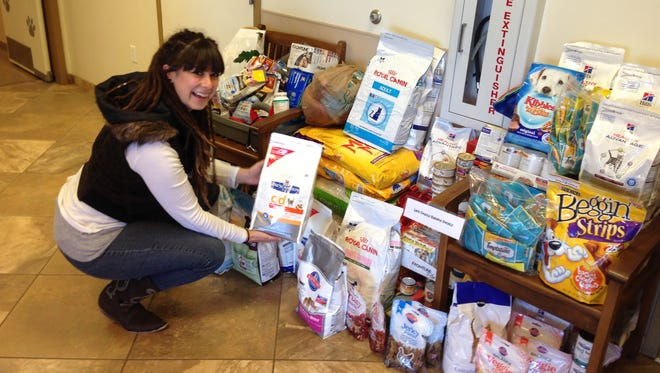 Sabrina Rodriguez de Conte, executive director of the Leon County Humane Society, checks out her group's share of the goodies.