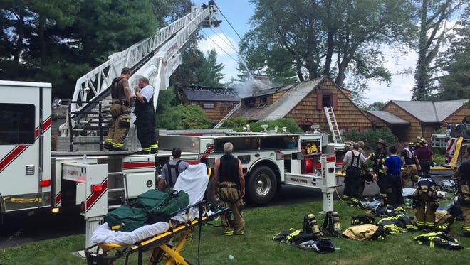 Firefighters at a blaze at a Long Hill Road East home.