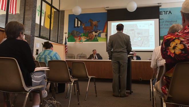 The Henrietta Town Board hears a presentation about the proposed rezoning of the old Monroe County Fairgrounds site.