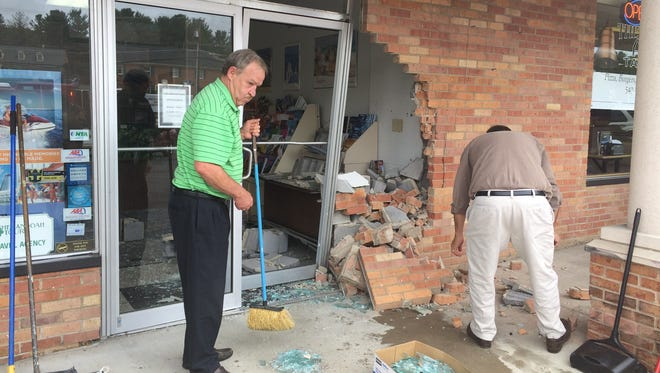 A car slammed into a Staunton business Monday afternoon, collapsing a wall.