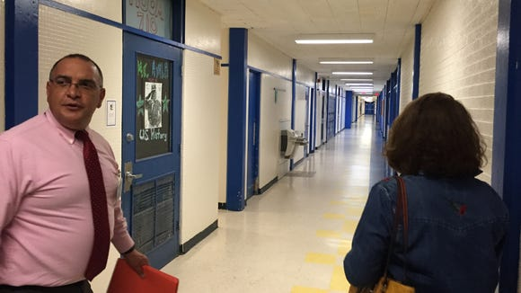 An Yselta Independent School District administrator and district resident Irma Baca walk through a hallway at Eastwood High School on Oct. 7.