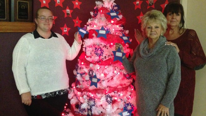 Nikki Watterson, Judith Cooley and Lyn Murray with the Veterans Christmas Tree.