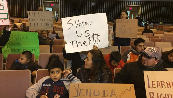 Parents protest at a recent school board meeting in