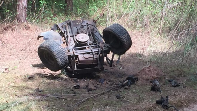 A screen grab from a video shows the remains of the riding lawn mower that was destroyed by explosives.