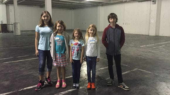 A stop on the tour of the Statesman Journal building with Dakota, left to right, Felicity, Kendra, Bente and Noah during Take Our Daughters and Sons to Work Day.